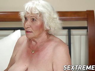 Short hair grandma teases with large love melons previous to fucking