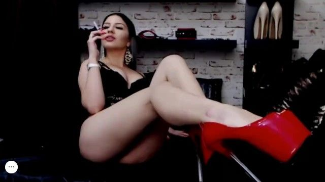 Red high heels, red nails, hot smoker playing on webcam
